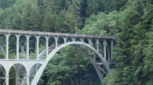The iconic Cape Creek Bridge, near Heceta Head on the Oregon coast, was built in the early 1930s.